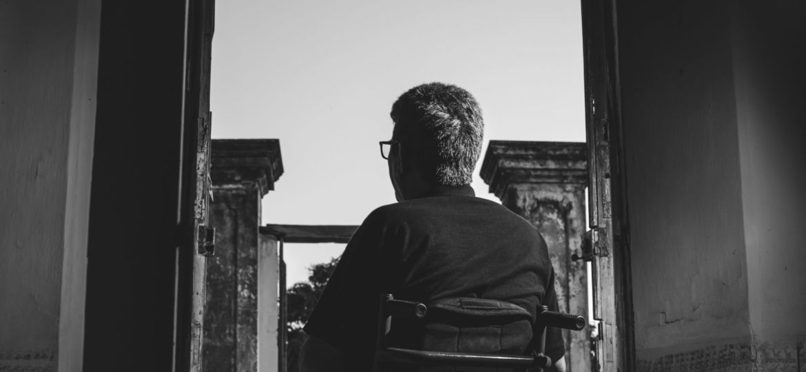 grayscale-photography-of-man-sitting-on-wheelchair-3044623